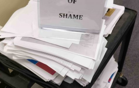 """Drowning in Paper and Ink, Meet the Library's """"Pile of Shame"""""""