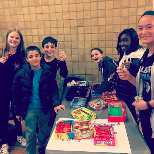 PLOP peer leader, Katherine Wenzel (far left), assists customers on the 1st day of the Candy Cane Drive.